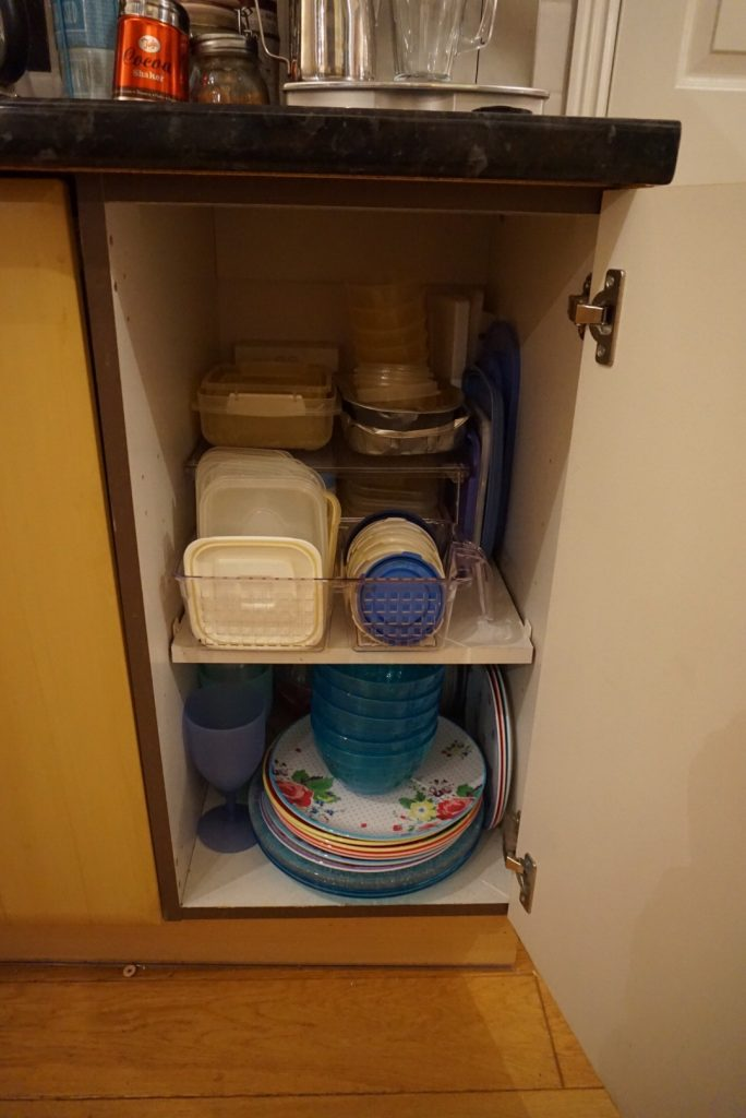 A neatly stored and organised Tupperware cupboard