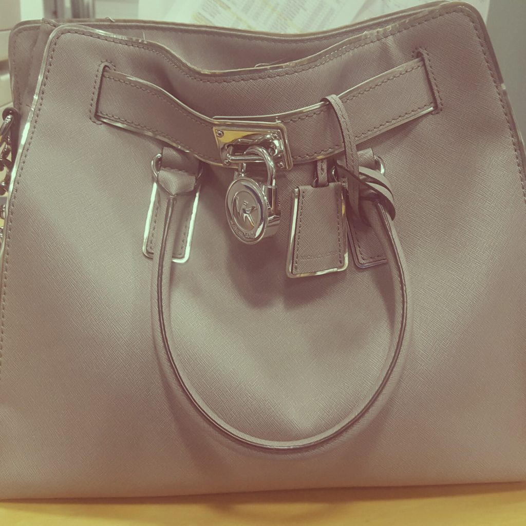 Abi's work bag is from Michael Kors