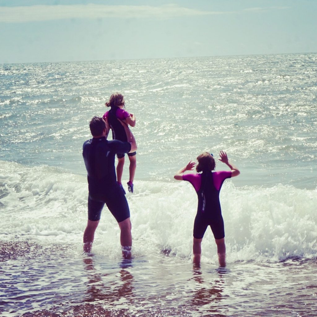 Hours of fun wave jumping on Freshwater Beach Dorset