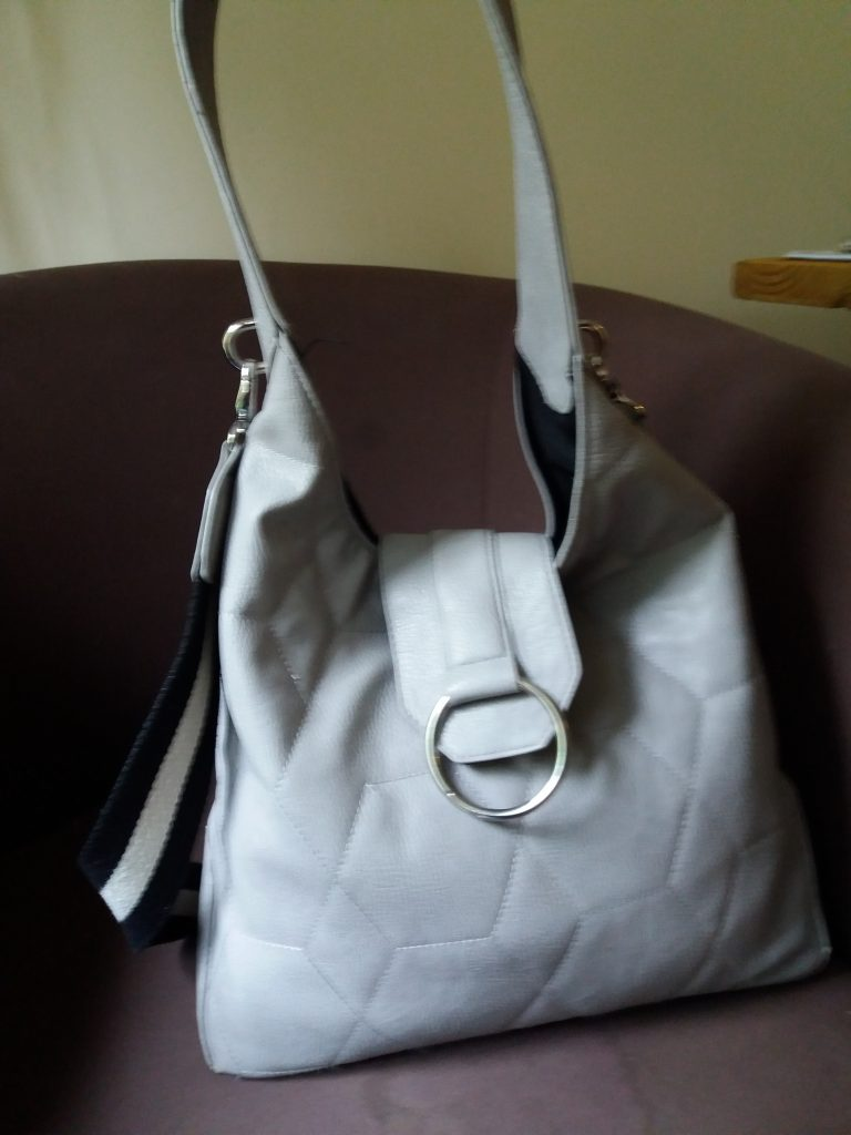 Carolines bag is a shoulder bag and the colour is a soft blue