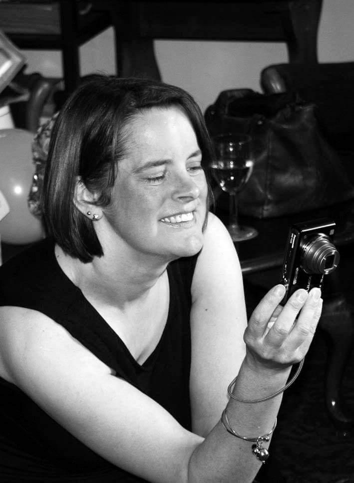 Caroline Richardson holding a camera taking a photo
