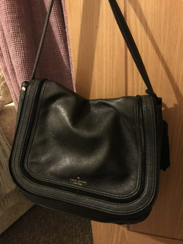 Lucy's bag is a over the shoulder black bag