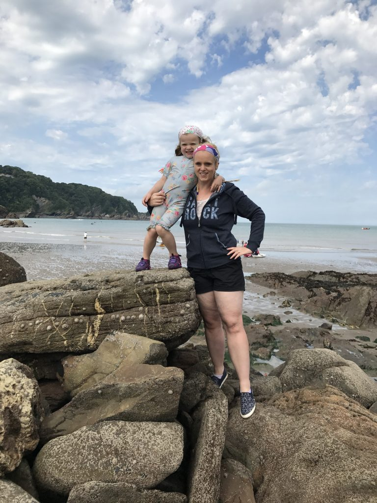Lucy Mackcraken stood on a beach with her daughter